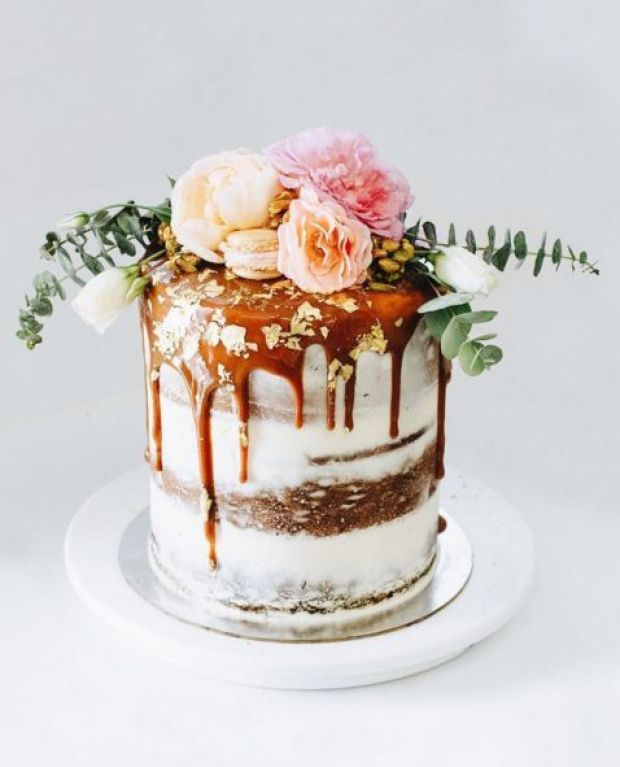12-dirty-frosted-wedding-cake-with-caramel-drip-and-lush-pastel-flowers-and-greenery.jpg