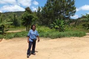 Rose Marie Randrianarison (Madagascar Program Coordinator) standing at the library building site (photo © LVDI International)