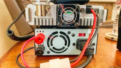 Power supply and radio with cooling fans