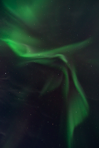 Night sky displaying aurora borealis corona (diverging rays) -taken near Fairbanks, Alaska