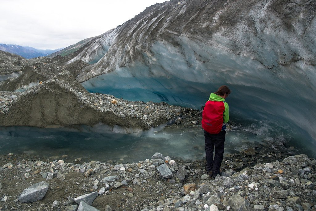 Crossing a stream on the Canwell Glacier