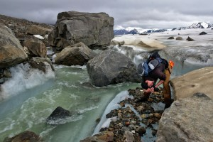 taking pictures next to a glacier stream