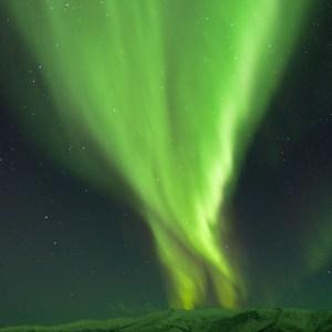 Aurora borealis over the Chena hills from the Angel Rocks Trail. Chena River Recreation Area, Alaska