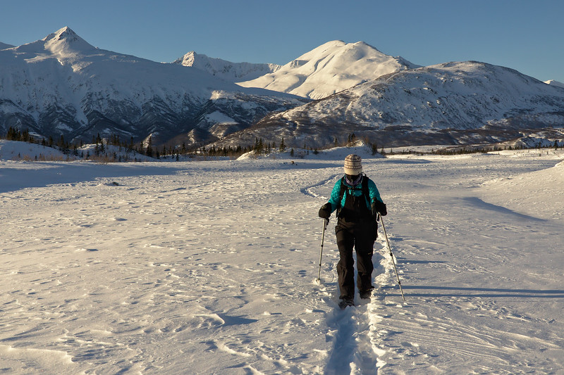 Jenn snowshoeing up Caster Creek to the toe of the Glacier
