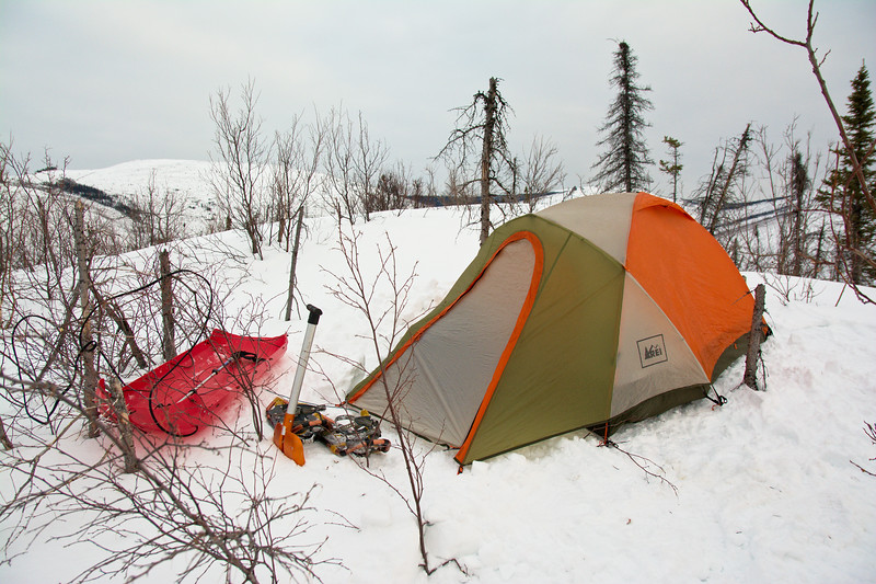My little campsite. I shoveled and stomped out a nice platform for the tent in my snowshoes. Waited a while for it to firm up. It didn't, so I stomped it out some more. Waited another 15 minutes. Set up the tent and took of my snowshoes.