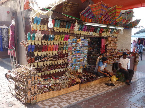 Beautifully woven shoes hung on display