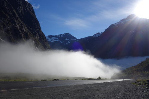 Amidst the clouds with the sun rays seeping through as we trot along to Milford Sound