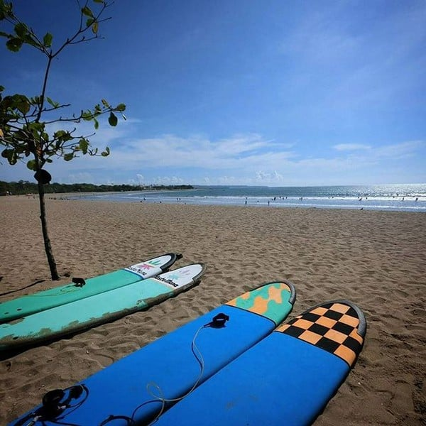 Surf that wave, our beautiful surfboards overlooking kuta beach