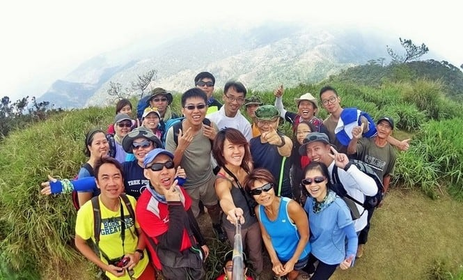 Team spirit at the top of Mount Ugo