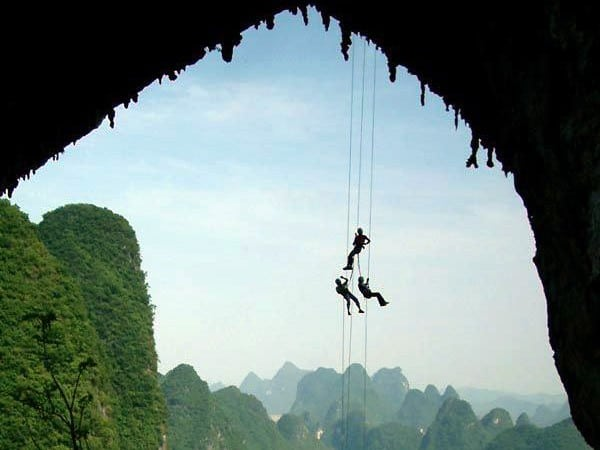 Abseiling down from Moonhill in Yangshuo - image credited to topguilintravel