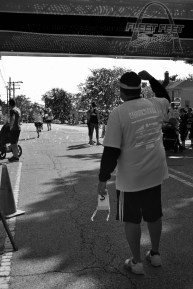 This guy was standing at the finish line encouraging the runners.