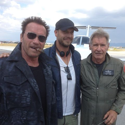 """Courtesy Arnold Schwarzenegger's Facebook Arnold Schwarzenegger, Director Patrick Hughes and Harrison Ford on the set of """"The Expendables 3."""""""