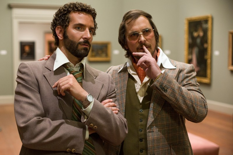 Francois Duhamel/Annapurna Productions Richie Dimaso (Bradley Cooper) and Irving Rosenfeld (Christian Bale) talk in a gallery at the Frick Museum