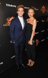 "David M. Benett/Getty Images Sam Claflin (L) and Laura Haddock attend Lionsgate's ""The Hunger Games: Mockingjay Part 1"" party at a private villa."
