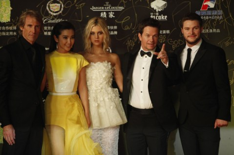 """Kevin Lee/Getty Images (L to R) Director Michael Bay,  Li Bingbing, Nicola Peltzat, Mark Wahlberg, and Jack Reynor poses for a picture. at the Shanghai premiere of """"Transformers."""""""