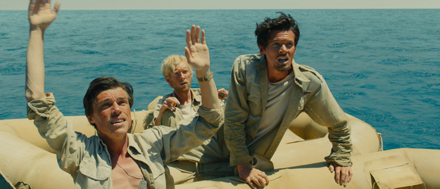 """Universal Pictures Mac (Finn Witrock), Phil (Domhnall Gleeson) and Louie (Jack O'Connell) are adrift in """"Unbroken"""","""