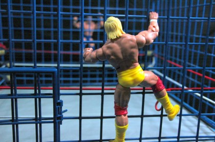 Hulk Hogan Defining Moments figure - racing down cage against Mr. Wonderful