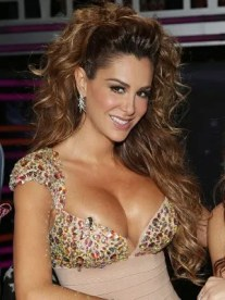 Ninel Conde - low cut dress