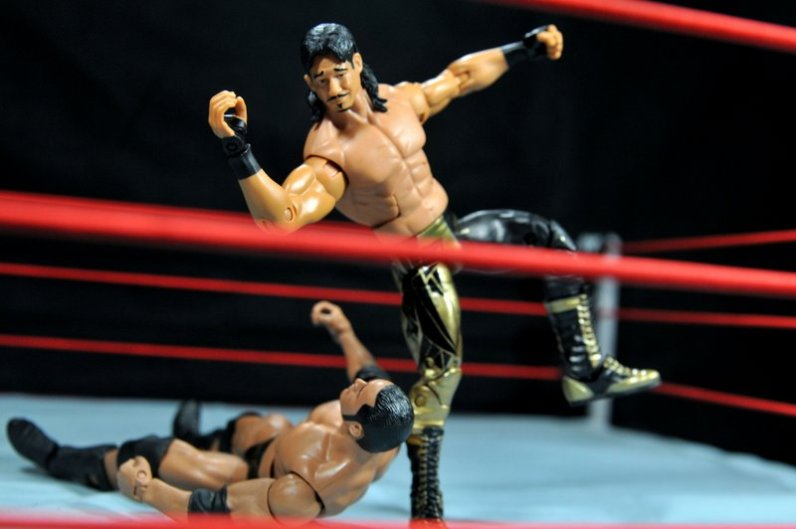 Eddie Guerrero Hall of Fame figure review -elbow to The Rock