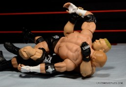 Mattel Brock Lesnar WWE figure - putting Kimura lock on Triple H