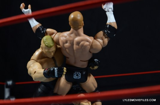 Mattel Brock Lesnar WWE figure - tackling Triple H