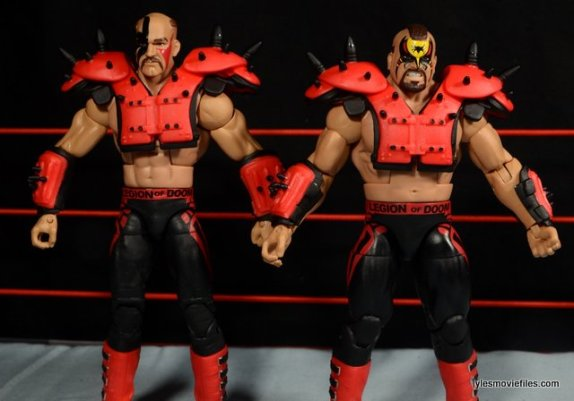Mattel WWE Elite 30 Legion of Doom - showing off football pads