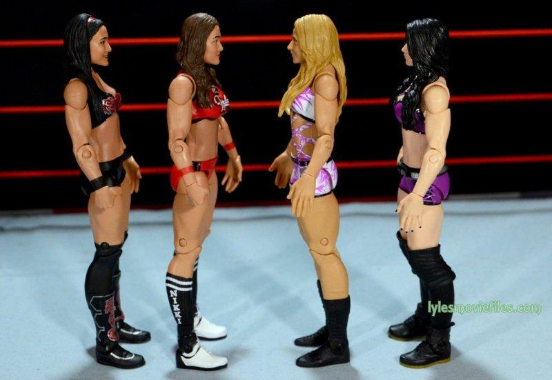 Nikki Bella Mattel WWE figure - scale shot with Brie Bella, Emma and Paige