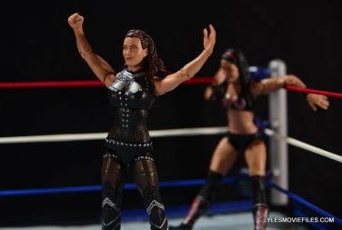 Mattel WWE Elite 37 Stephanie McMahon -dropping Brie Bella in the corner