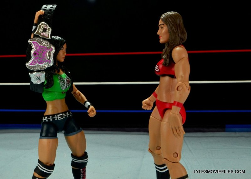 WWE Mattel Basic AJ Lee - raising belt at Nikki Bella 2
