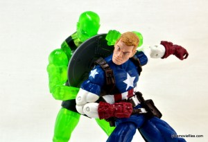 Marvel Legends three-pack Ms. Marvel, Captain America and Radioactive Man -Radioactive Man pulling shield