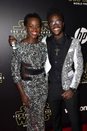 "HOLLYWOOD, CA - DECEMBER 14: Actress Lupita Nyong'o (L) and Peter Nyong'o attend the World Premiere of ""Star Wars: The Force Awakens"" at the Dolby, El Capitan, and TCL Theatres on December 14, 2015 in Hollywood, California. (Photo by Kevin Winter/Getty Images for Disney) *** Local Caption *** Lupita Nyong'o;Peter Nyong'o"