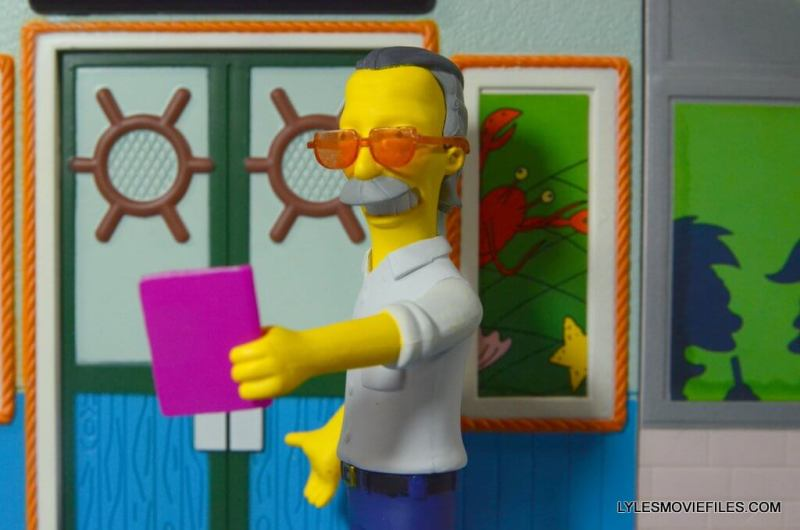 The Simpsons NECA Stan Lee figure -handing the book over