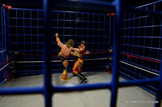 Ultimate Warrior Hall of Fame figure -battling Rude in the cage