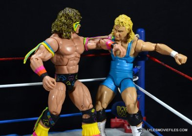 Ultimate Warrior Hall of Fame figure -chopping Mr Perfect