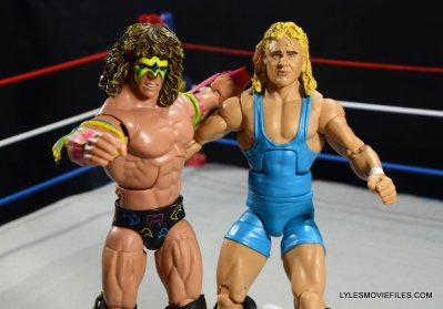 Ultimate Warrior Hall of Fame figure -grabbing Mr. Perfect