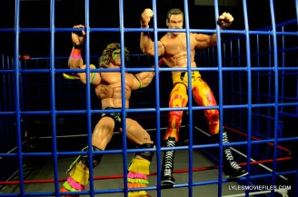 Ultimate Warrior Hall of Fame figure -smashing Rude on cage