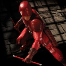 Dardevil One 12 Mezco Toyz figure - against brick blackdrop