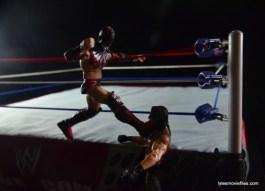 WWE Elite 41 Finn Balor -apron kick to Seth Rollins