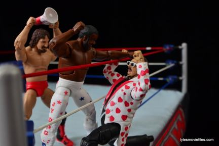 WWE Hall of Fame Jimmy Hart figure -about to get hit by JYD-min