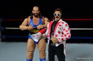 WWE Hall of Fame Jimmy Hart figure -with Earthquake-min