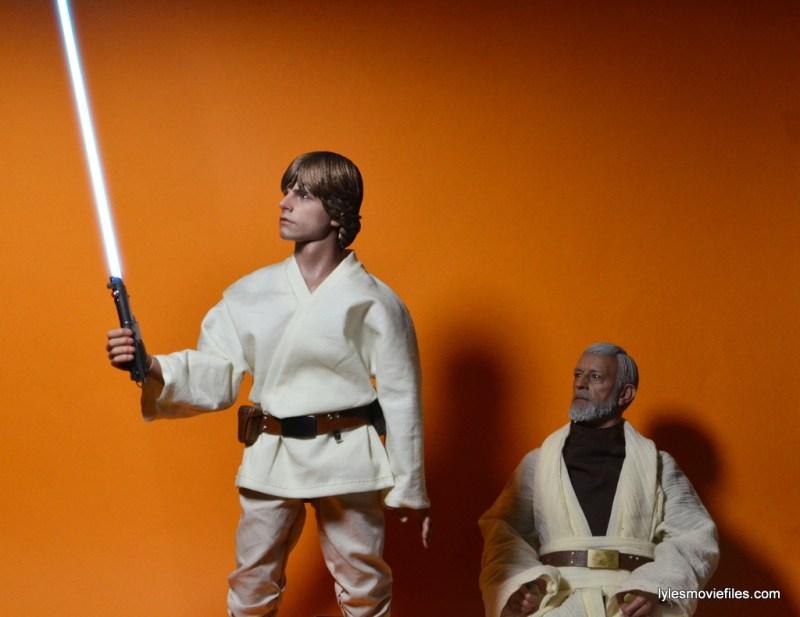 Hot Toys Luke Skywalker figure review - Luke holding lightsaber Obi-Wan looks on