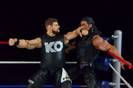 WWE Elite 43 Kevin Owens figure review - elbowing Roman Reigns