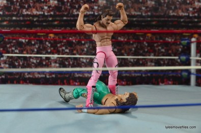 wwe-elite-40-rick-rude-figure-review-posing-over-jake-the-snake