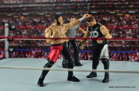 wwe-elite-43-samoa-joe-figure-review-punching-kevin-owens