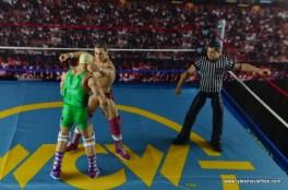 WWE Elite 45 Steve Regal figure review - forearm to Finley