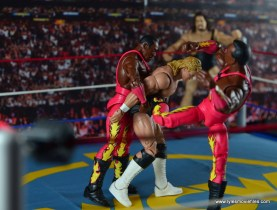 WWE Elite 46 Harlem Heat figure review - side kick to Luger