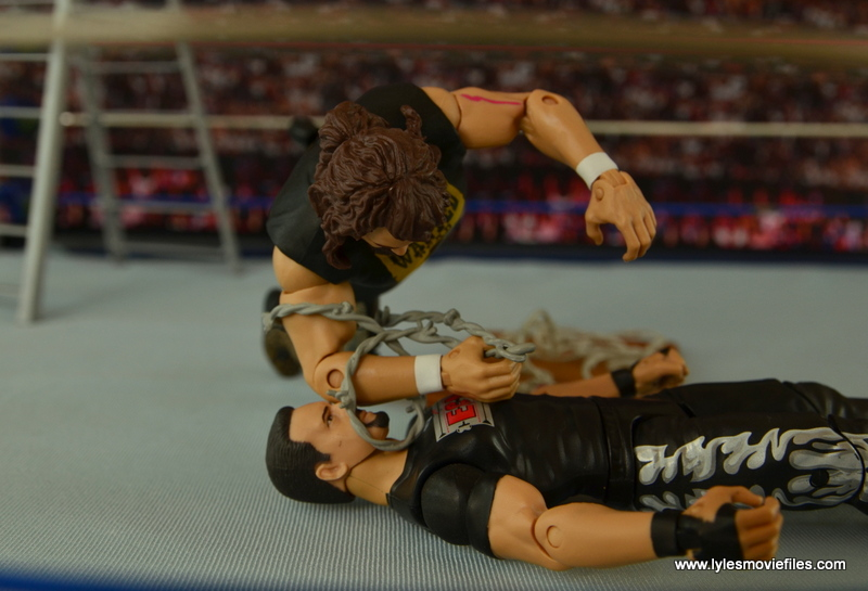 WWE Elite 48 Cactus Jack figure review -barbed wire elbow to Tommy Dreamer