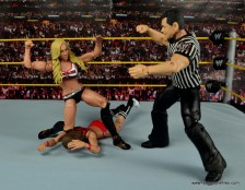 WWE Carmella figure review - kneeling over Nikki Bella