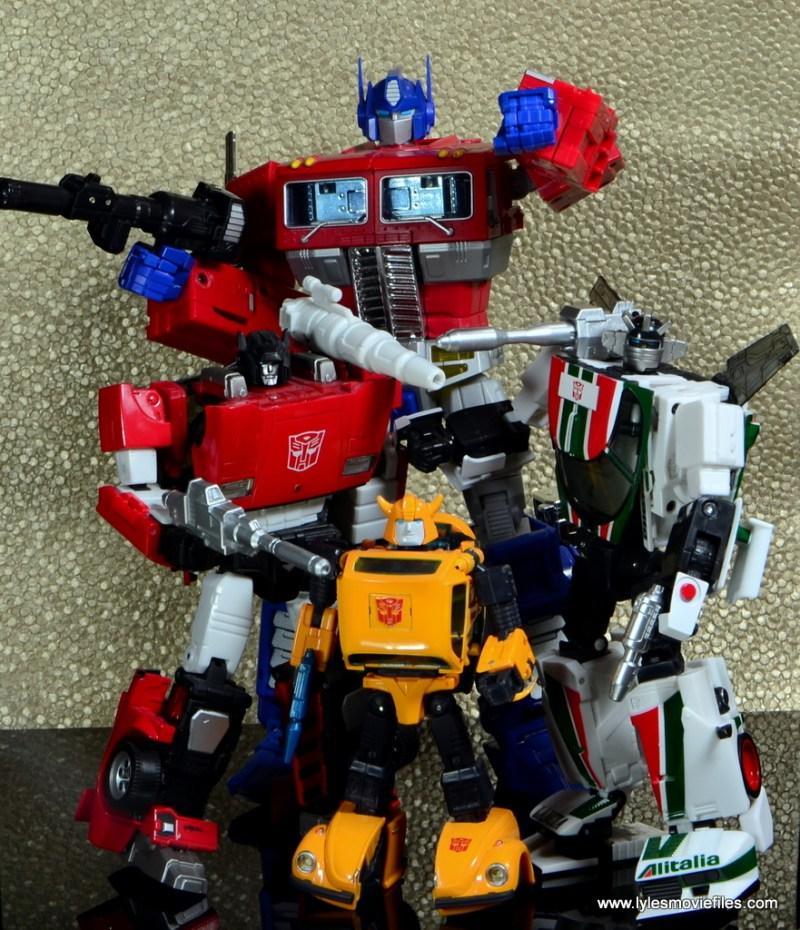 Transformers Masterpiece Wheeljack figure review - Devestation roster Sideswipe, Optimus Prime Aand Bumblebee