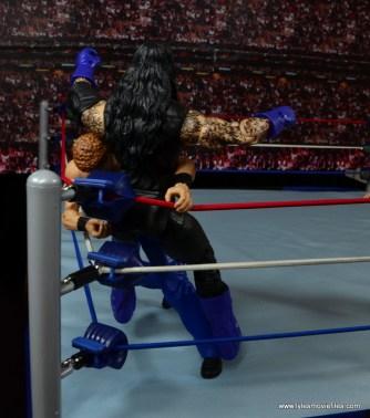 WWE Elite Isaac Yankem figure review -shoulder tackle to Undertaker in corner